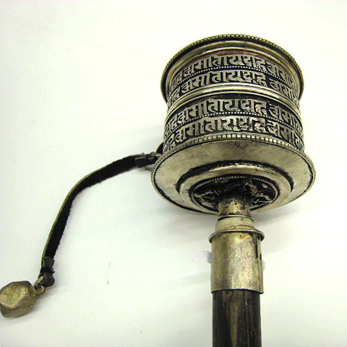 Prayer wheel Tibet. Mani script WM